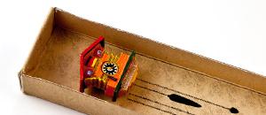 Der Kuckucksuhr-Mini-Magnet in seiner Packung